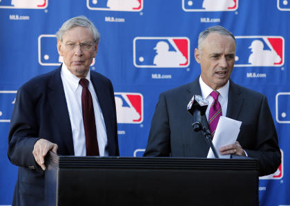 The transition from Bud Selig, left, to Rob Manfred is expected to be seamless. (AP)