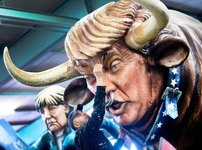 An artist works for media on a figure depicting US President Donald Trump as a bull during a press preview in a hall of the Mainz carnival club in Mainz, Germany,Tuesday, Feb. 26, 2019. Carnival groups and clubs in Germany are putting their final touches on their elaborate floats with outrageous caricatures depicting political themes for this year's parades during Carnival celebrations. (Photo: Michael Probst/AP)