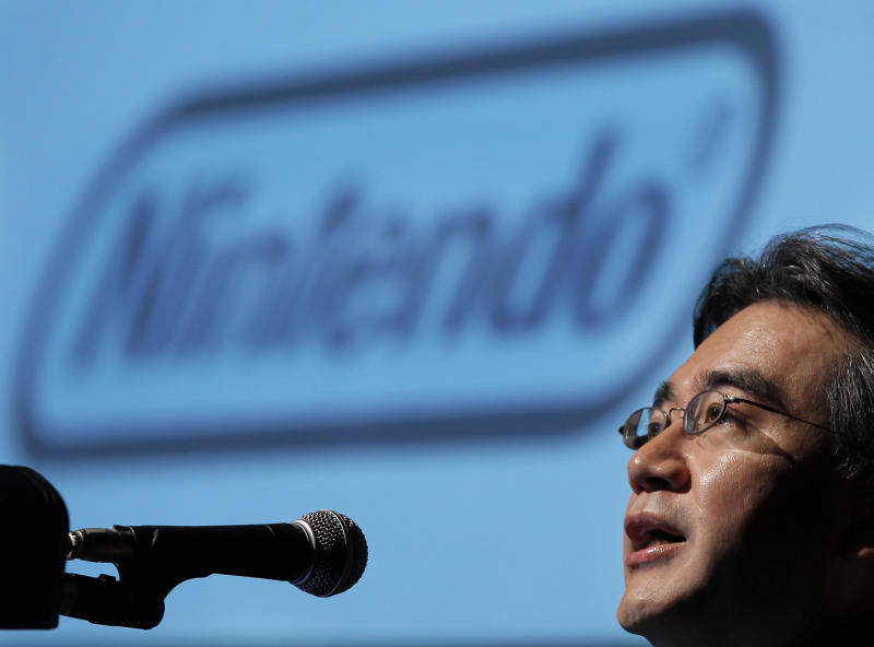 Nintendo Co., Ltd. President and CEO Satoru Iwata speaks during the company's financial results briefing in Tokyo Friday, Oct. 29, 2010. Kyoto-based Nintendo sank to a first-half loss, its first in seven years, as a rising yen and long-delayed release of its 3-D gaming machine set the scene for a weak full-year result. Nintendo Co. said it posted a 2.01 billion yen ($24.7 million) loss for the six months through September. First-half sales dropped nearly 34 percent to 363.2 billion yen ($4.46 billion). (AP Photo/Itsuo Inouye)