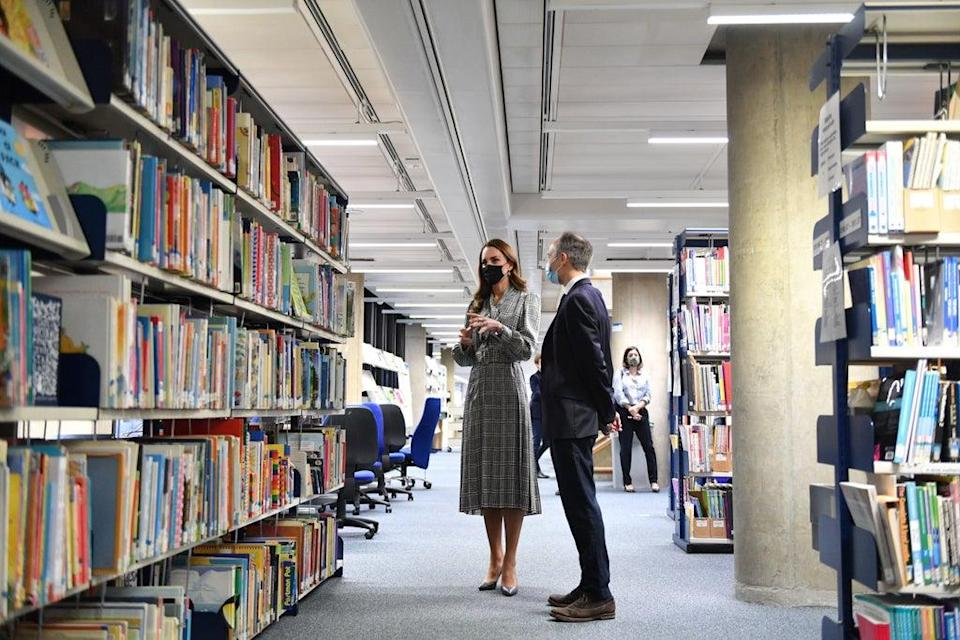 The Duchess of Cambridge is show around the library by Professor Pasco Fearon during her UCL visit (Justin Tallis/PA) (PA Wire)