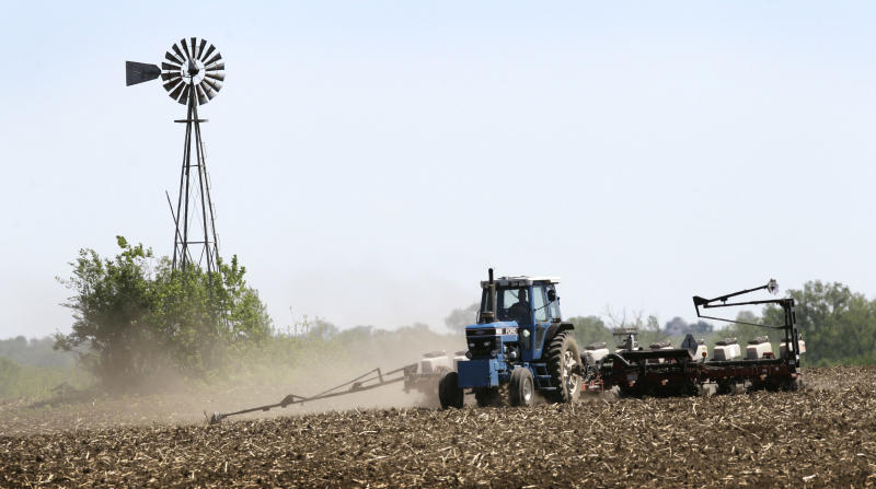 Andy Hall plants corn in a field, Thursday, May 10, 2012, near Bondurant, Iowa. The U.S. Department of Agriculture estimates a record corn crop this year, topping the previous high by 11 percent.(AP Photo/Charlie Neibergall)