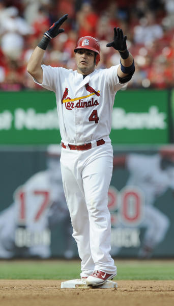 St. Louis Cardinals' Yadier Molina celebrates his double against the Pittsburgh Pirates in the fourth inning in a baseball game Saturday, Aug. 18, 2012, in St. Louis. (AP Photo/Bill Boyce)