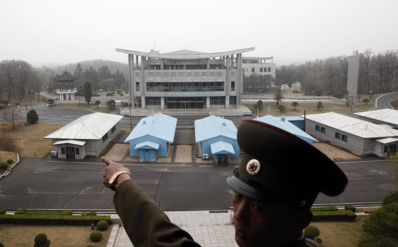 """A North Korean military officer points in the direction of South Korea in front of the truce village of Panmunjom at the Demilitarized Zone (DMZ) which separates the two Koreas, North Korea, Monday, April 23, 2012. North Korea promised Monday to reduce South Korea's conservative government """"to ashes"""" in less than four minutes, in an unusually specific escalation of recent threats aimed at its southern rival. (AP Photo/Ng Han Guan)"""