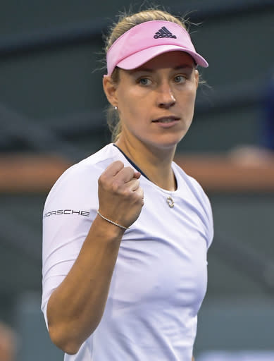 Angelique Kerber, of Germany, celebrates after defeating Venus Williams at the BNP Paribas Open tennis tournament Thursday, March 14, 2019, in Indian Wells, Calif. (AP Photo/Mark J. Terrill)