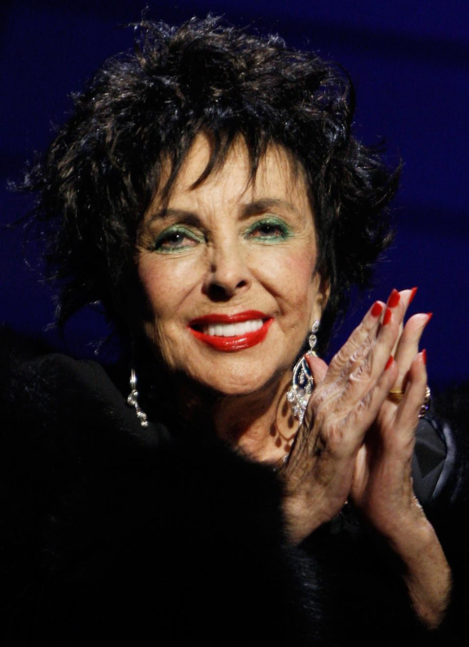 """<strong>Elizabeth Taylor (27 February 1932 to 23 March 2011)</strong> <br><br>Film stars don't get much bigger than Elizabeth """"Liz"""" Taylor, a true heavyweight on the silver screen over the last 60 years. Most known for her starring roles in 'National Velvet', 'Cat on a Hot Tin Roof', 'Cleopatra' and 'Who's Afraid of Virginia Woolf?', Taylor became an international sex symbol and was known for her glamorous lifestyle.<br><br>Born in London to American parents, Taylor moved to Los Angeles at an early age where she attracted attention from a number of film studios. Impressed with her looks, Universal signed Taylor up for a seven-year contract before she had even turned nine. This would last just one film, Taylor moved on to MGM who cast her in 'Lassie Come Home' and then 'National Velvet' – a film that propelled Taylor into the spotlight aged just 12.<br><br>Making the move to adult roles, Taylor became a Hollywood star. She hit her peak in the late 1950s – with four consecutive Oscar nominations from 1958 to 1961. Taylor picked up an Oscar for her performance in 'Butterfield 8' and a second for 'Who's Afraid of Virginia Woolf' in 1966 , though was perhaps best known for playing Cleopatra in the blockbuster film of the same name.<br><br>Taylor's personal life also dominated the headlines, she married eight times over the 79 years of her life including to 'Cleopatra' co-star Richard Burton. <br><br>From the 1980s onward Taylor took to campaigning – championing, founding and promoting HIV and AIDS programmes."""