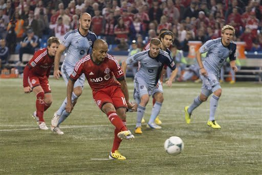 Toronto FC's Robert Earnshaw scores from the penalty spot against Sporting Kansas City during first half MLS soccer action in Toronto on Saturday, March 9, 2013. (AP Photo/The Canadian Press, Chris Young)