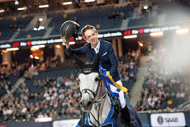 Equestrian - Sweden International Horse Show - FEI Grand Prix Two Rounds - Friends Arena, Stockholm, Sweden - December 3, 2017 - Bertram Allen of Ireland on his horse Gin Chin Van Het Lindenhof celebrates after winning. TT News Agency/Jessica Gow via REUTERS ATTENTION EDITORS - THIS IMAGE WAS PROVIDED BY A THIRD PARTY. SWEDEN OUT. NO COMMERCIAL OR EDITORIAL SALES IN SWEDEN