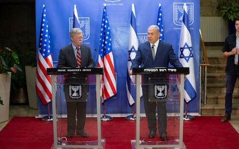Israeli Prime Minister Benjamin Netanyahu, right, speaks during his meeting with US national security adviser John Bolton at the Prime Minister's office in Jerusalem. - Credit: AP