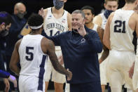 Penn State's coach Penn State coach Jim Ferry approaches Jamari Wheeler (5) during a time out in the second half of an NCAA college basketball game, Saturday, Jan. 30, 2021, in State College, Pa. (AP Photo/Gary M. Baranec)