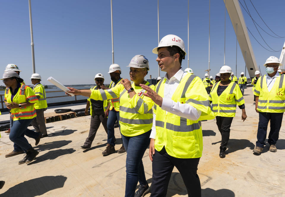 Secretary of Transportation Pete Buttigieg, right, visits the Frederick Douglass Memorial Bridge construction site together with District of Columbia Mayor Muriel Bowser and Secretary of Labor Marty Walsh, in southeast Washington, Wednesday, May 19, 2021. (AP Photo/Manuel Balce Ceneta)