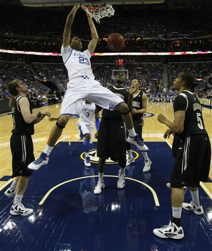 Kentucky forward Anthony Davis (23) dunks the ball over the Vanderbilt defense during the first half of an NCAA college basketball game in the championship game of the Southeastern Conference tournament at the New Orleans Arena in New Orleans, Sunday, March 11, 2012. (AP Photo/Gerald Herbert)