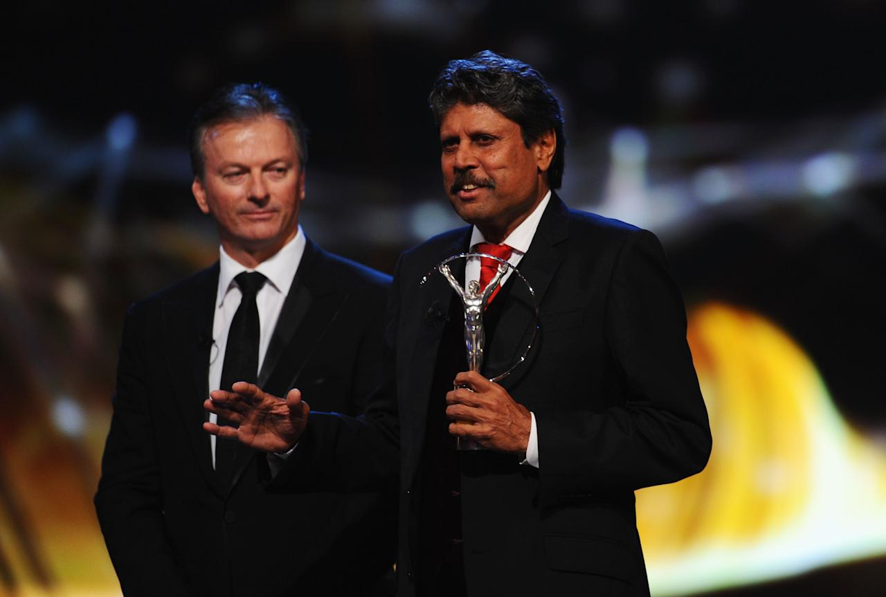 KUALA LUMPUR, MALAYSIA - MARCH 26:  Laureus Academy member Kapil Dev and Steve Waugh speaks on stage during the 2014 Laureus World Sports Award show at the Istana Budaya Theatre on March 26, 2014 in Kuala Lumpur, Malaysia.  (Photo by Mike Hewitt/Getty Images for Laureus)