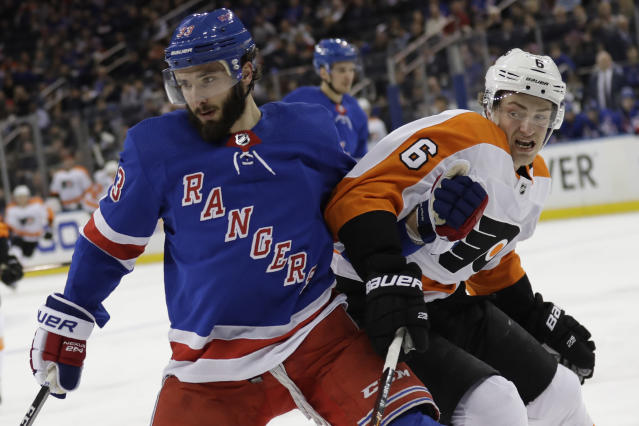 New York Rangers' Phillip Di Giuseppe, left, and Philadelphia Flyers' Travis Sanheim compete for the puck during the second period of the NHL hockey game, Sunday, March 1, 2020, in New York. (AP Photo/Seth Wenig)