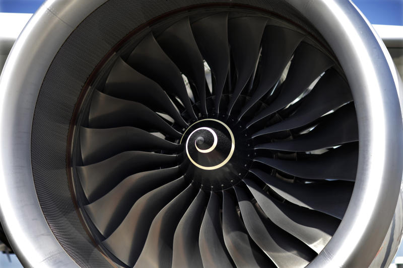 FILE- This July 16, 2015, file photo shows the blades of a Rolls-Royce engine on an Airbus A350 XWB test flight aircraft, parked at Newark Liberty international airport in Newark, N.J. British plane engine manufacturer Rolls-Royce said Thursday, June 14, 2018, that it plans to cut 4,600 jobs over the next 2 years as part of a major restructuring effort. (AP Photo/Mel Evans, File)