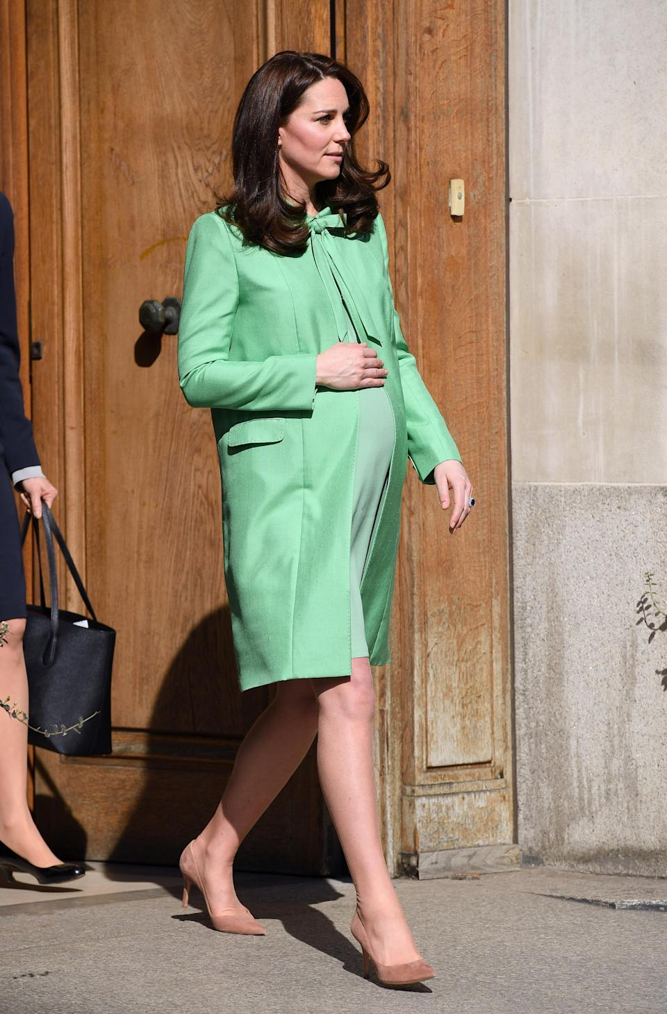The Duchess holds her bump on a recent public appearance [Photo: Getty]