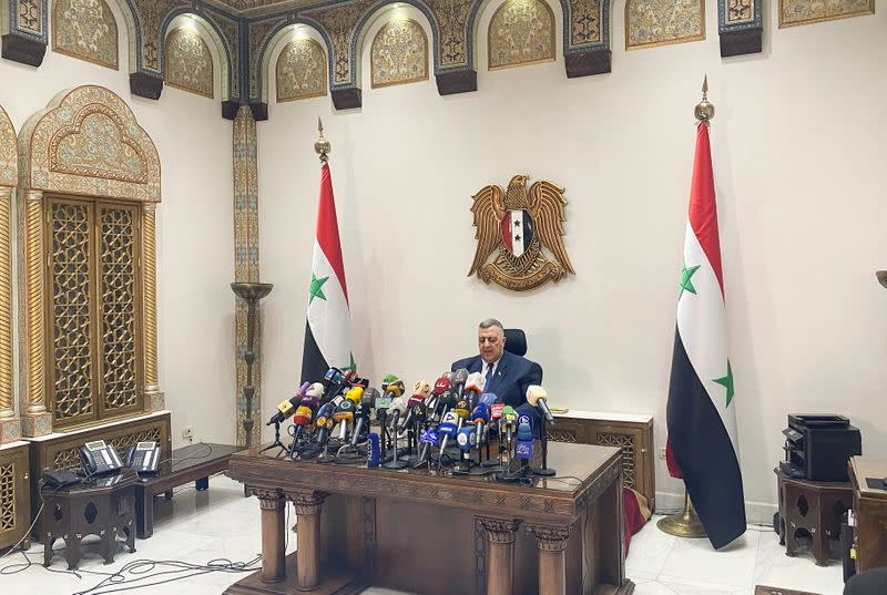 Parliament Speaker Hammouda Sabbagh announces the results of the Syrian presidential election at the Syrian parliament building in Damascus