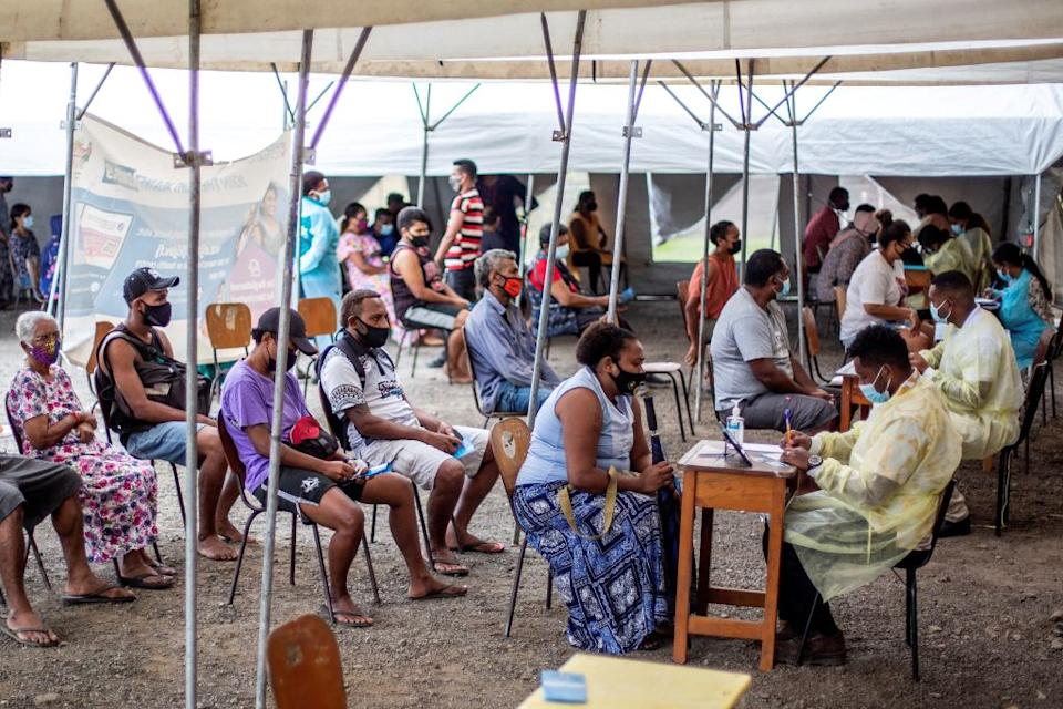 Fijians queueing for a dose of AstraZeneca. Source: Getty