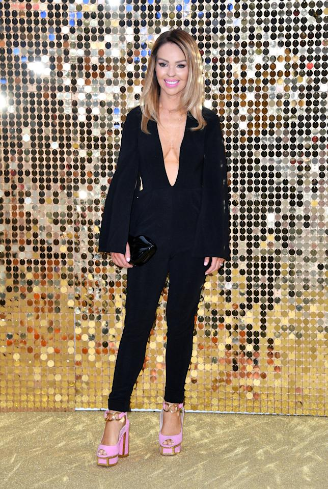 <p>Katie showed off her enviable figure on the Ab Fab red carpet in a plunging Rare London jumpsuit, paired with stacked Kat Maconie heels.<i>[Photo: Getty]</i></p>