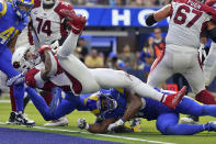 Arizona Cardinals running back James Conner, top, scores a touchdown during the second half in an NFL football game against the Los Angeles Rams Sunday, Oct. 3, 2021, in Inglewood, Calif. (AP Photo/Ashley Landis )