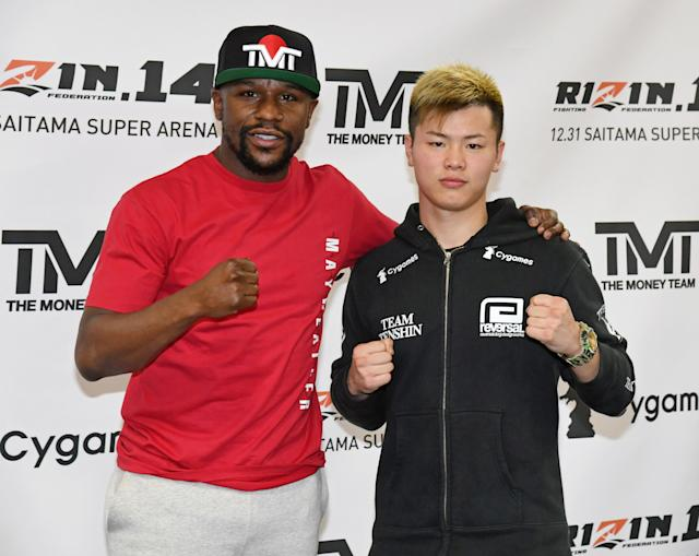 Floyd Mayweather Jr. (L) and Tenshin Nasukawa pose during a news conference at the Mayweather Boxing Club on Thursday. (Ethan Miller/Getty Images)
