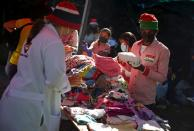 Volunteers sort donated clothes to be handed out to families in need, in Guarenas