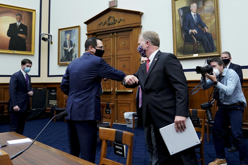 Treasury Secretary Steven Mnuchin elbow bumps with Rep, Kevin Hern, R-Okla., after a House Small Business Committee hearing on oversight of the Small Business Administration and Department of Treasury pandemic programs on Capitol Hill in Washington, Friday, July 17, 2020. (Erin Scott/Pool via AP)