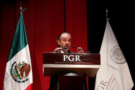 Attorney General Raul Cervantes speaks during a formal apology to three indigenous women who were wrongfully jailed for years, in Mexico City, Mexico February 21, 2017. REUTERS/Carlos Jasso