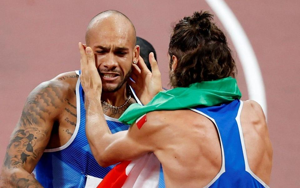 Lamont Marcell Jacobs of Italy celebrates winning gold with high jump gold medalist Gianmarco Tamberi of Italy - Reuters