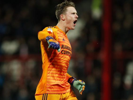 Sheffield United's Dean Henderson celebrates the Blades' opener (Action Images)