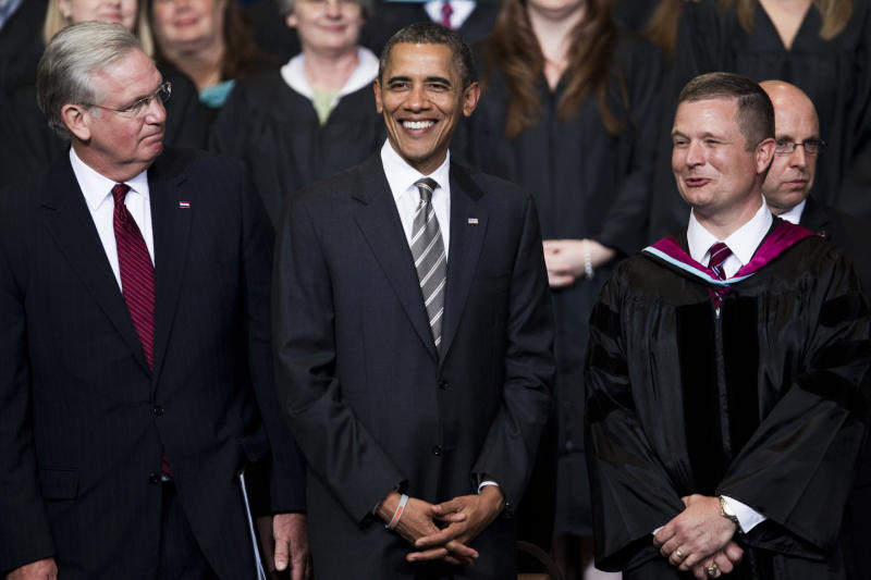 Missouri Gov. Jay Nixon, left, and Joplin Superintendent of Schools C.J. Huff, right, flank President Barack Obama as he takes the stage to deliver the Joplin High School commencement address a day before the anniversary of the twister that killed 161 people, Monday, May 21, 2012, in Joplin, Mo. Obama jetted to Joplin immediately after wrapping up the national security-focused NATO conference in Chicago, the second international summit the president hosted over the past four days. (AP Photo/The Kansas City Star, Shane Keyser)