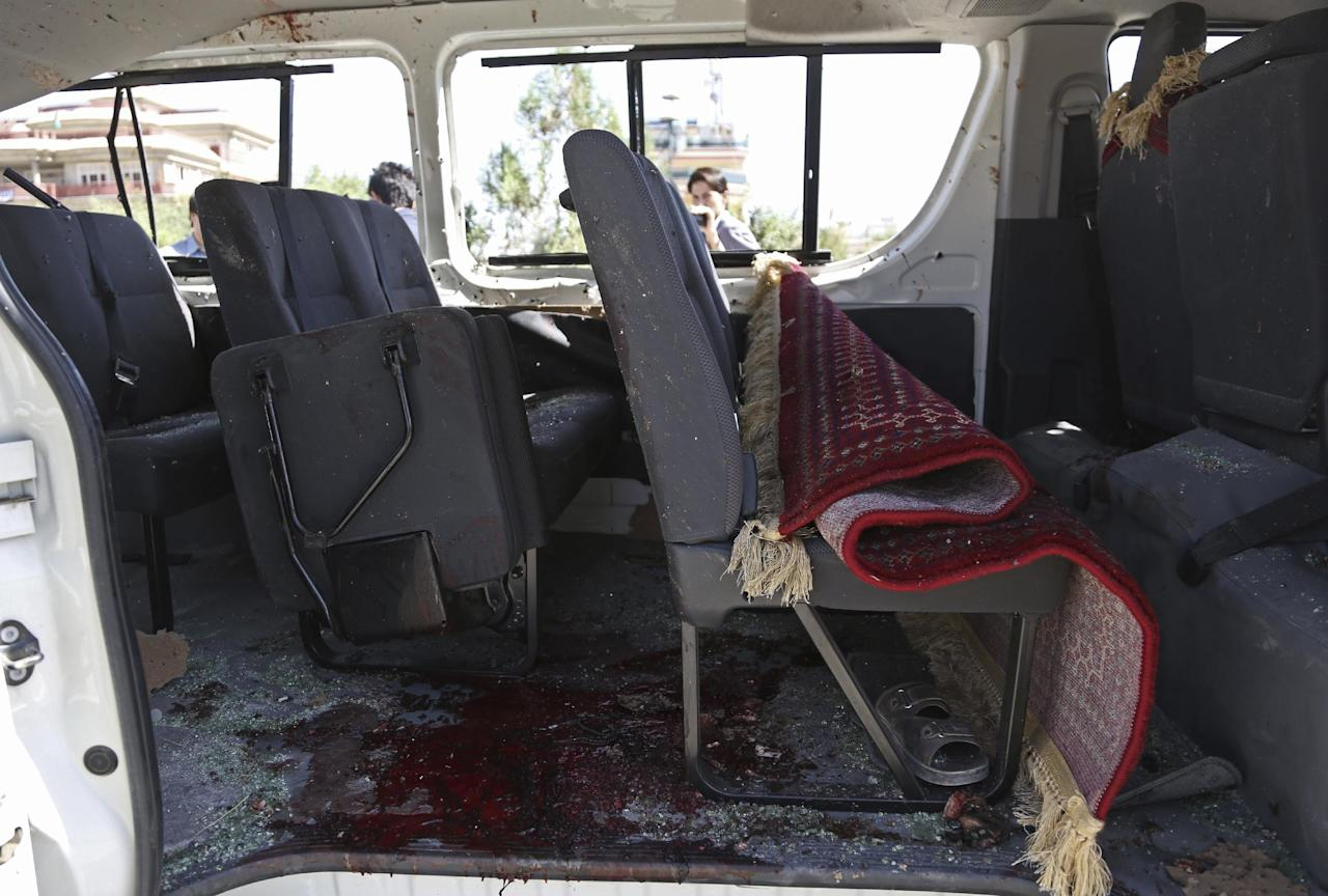 The damaged interior of a vehicle is seen at the site of a bomb blast on the outskirts of Kabul, Afghanistan, Tuesday, July 15, 2014. Gul Agha Hashimi, the chief of criminal investigations with the Kabul police, says the explosion struck a minivan carrying seven staffers of the palace's media office on Tuesday morning. The blast killed two passengers and also wounded five people, including the driver. (AP Photo/Rahmat Gul)