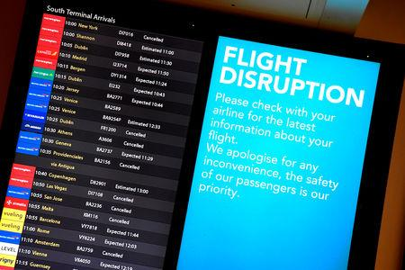 FILE PHOTO: An arrivals board in the South Terminal building at Gatwick Airport, after the airport reopened to flights following its forced closure because of drone activity, in Gatwick, Britain, December 21, 2018. REUTERS/Toby Melville/File Photo