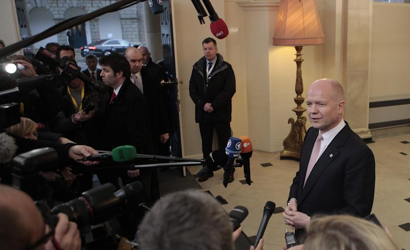 United Kingdom's Foreign Secretary William Hague speaks to the media on arrival for the European Informal Meeting of Ministers for Foreign Affairs at Dublin Castle, Ireland, Friday, March 22, 2013. (AP Photo/Peter Morrison)