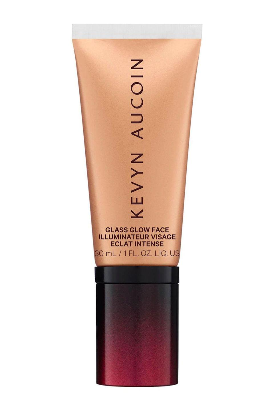 """<p><strong>Kevyn Aucoin</strong></p><p>bluemercury.com</p><p><strong>$32.00</strong></p><p><a href=""""https://go.redirectingat.com?id=74968X1596630&url=https%3A%2F%2Fbluemercury.com%2Fproducts%2Fkevyn-aucoin-glass-glow-face-liquid-illuminator&sref=https%3A%2F%2Fwww.cosmopolitan.com%2Fstyle-beauty%2Fbeauty%2Fg36460987%2Fbest-face-gloss%2F"""" rel=""""nofollow noopener"""" target=""""_blank"""" data-ylk=""""slk:Shop Now"""" class=""""link rapid-noclick-resp"""">Shop Now</a></p><p>Think of this option from Kevyn Aucoin has a highlighter-gloss-<a href=""""https://www.cosmopolitan.com/style-beauty/beauty/g19505894/best-bronzer-makeup/"""" rel=""""nofollow noopener"""" target=""""_blank"""" data-ylk=""""slk:bronzer"""" class=""""link rapid-noclick-resp"""">bronzer</a> hybrid. It gives skin that glass-like glow you'd expect from a highlighter or face gloss, but thanks to its bronze pigments, it also <strong>instantly warms up your skin tone</strong> too.</p>"""