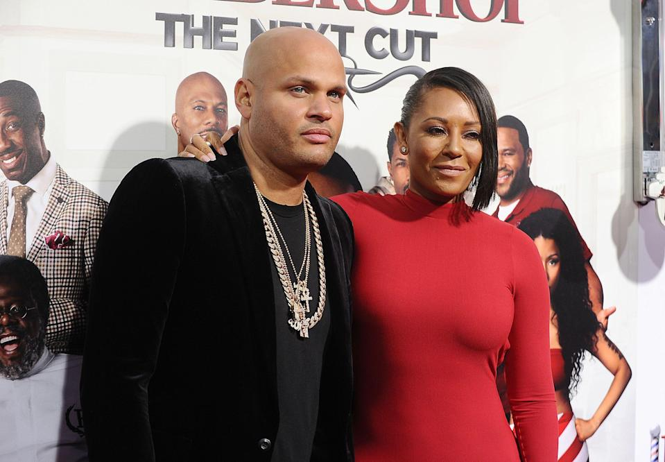 """HOLLYWOOD, CALIFORNIA - APRIL 06:  Stephen Belafonte and Melanie 'Mel B' Brown attend the premiere of """"Barbershop: The Next Cut"""" at TCL Chinese Theatre on April 6, 2016 in Hollywood, California.  (Photo by Jason LaVeris/FilmMagic)"""