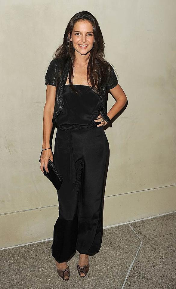 Katie Holmes decided to dump the dress and went for a black jumpsuit instead at the Giorgio Armani/Vanity Fair dinner hosted by actress Emma Stone, Giorgio's niece Roberta Armani, and editor Krista Smith. The event took place at a swanky private residence in Los Angeles on Tuesday night.   Jason Merritt/GettyImages.com - October 11, 2011