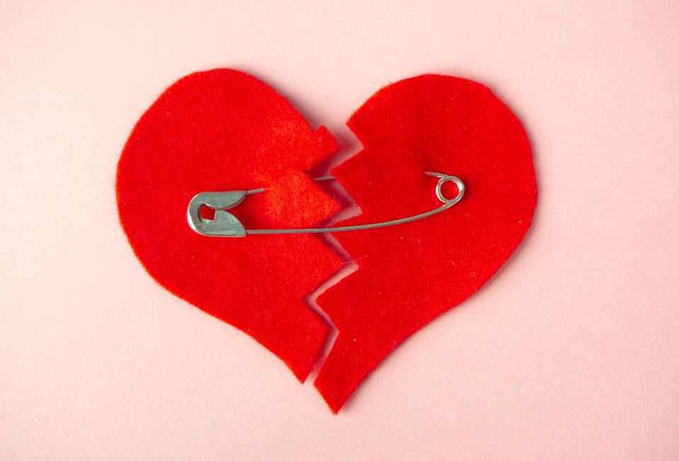 Love heart with a safety pin through it