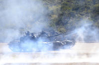 A line of Taiwan's tanks move during a military exercise in Hsinchu County, northern Taiwan, Tuesday, Jan. 19, 2021. Taiwanese troops using tanks, mortars and small arms staged a drill Tuesday aimed at repelling an attack from China, which has increased its threats to reclaim the island and its own displays of military might. (AP Photo/Chiang Ying-ying)