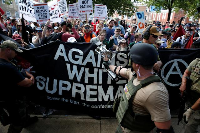 <p>Members of white nationalists are met by a group of counter-protesters in Charlottesville, Va., on Aug. 12, 2017. (Photo: Joshua Roberts/Reuters) </p>