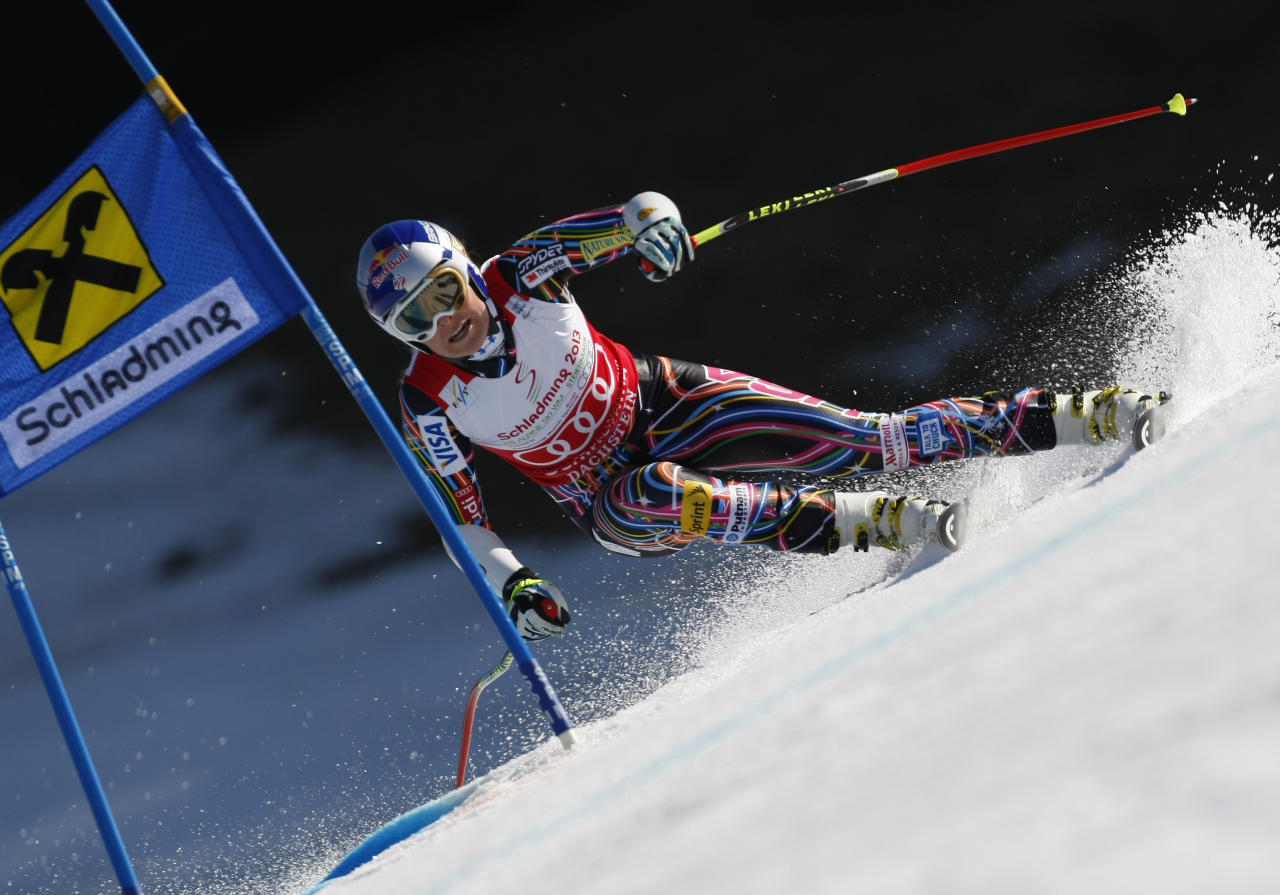SCHLADMING, AUSTRIA - MARCH 15: (FRANCE OUT) Lindsey Vonn of the USA wins the Overall World Cup SuperG globe during the Audi FIS Alpine Ski World Cup Women's SuperG on March 15, 2012 in Schladming, Austria. (Photo by Alexis Boichard/Agence Zoom/Getty Images)