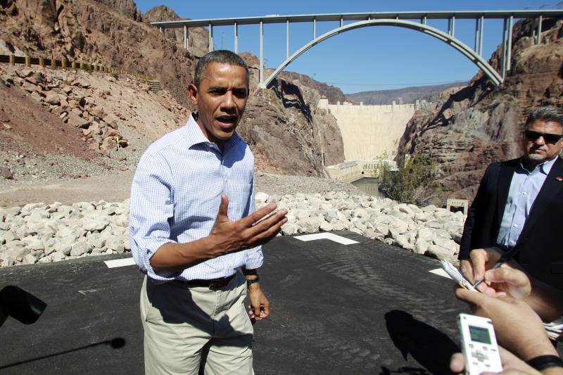 President Barack Obama talks to the media while visiting the Hoover Dam during a break from debate preparations Tuesday, Oct. 2, 2012. (AP Photo/Las Vegas Sun, Sam Morris, Pool)