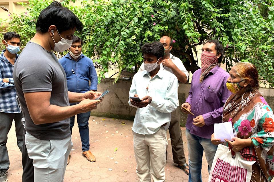<p>File image: Sonu Sood talks with needy people  gathered outside his residence to request for medical and financial assistance amid Covid-19</p> (Getty Images)