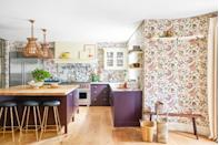 <p>This swirly wallpaper proves that making adventurous design decisions can pay off. In this kitchen designed by Rita Konig, the wallpaper in question is Antoinette Poisson's Jaipur. We love it even more paired with the rich purple-veined marble and painted cabinets. To protect it from water damage, Konig added an invisible glass over the wallpaper between the counter and cabinets. </p>
