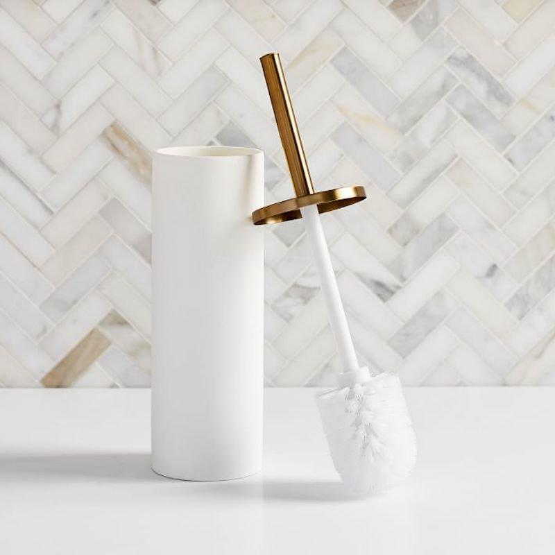 """<p>Just because a toilet brush has a dirty job doesn't mean it has to look dingy. Upgrade to this West Elm option, which keeps the brush hidden out of sight. </p> <p><strong>To buy: </strong>$29, <a href=""""http://westelm.7eer.net/c/249354/267856/4336?subId1=RS%2CSeriouslyStylishVersionsoftheGrossestHouseholdEssentials%25E2%2580%2594Yes%252CEvenPlungers%2Ckholdefehr1271%2CCLE%2CIMA%2C677348%2C201909%2CI&u=https%3A%2F%2Fwww.westelm.com%2Fproducts%2Fmodern-resin-stone-toilet-brush-holder-d5999%2F%3F"""" target=""""_blank"""">westelm.com</a>. </p>"""