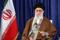 In this picture released by the official website of the office of the Iranian supreme leader, Supreme Leader Ayatollah Ali Khamenei addresses the nation in a televised speech, in Tehran, Iran, Thursday, April 9, 2020. Iran's supreme leader suggested Thursday that mass gatherings in the Islamic Republic may be barred through the holy Muslim fasting month Ramadan amid the new coronavirus pandemic. (Office of the Iranian Supreme Leader via AP)