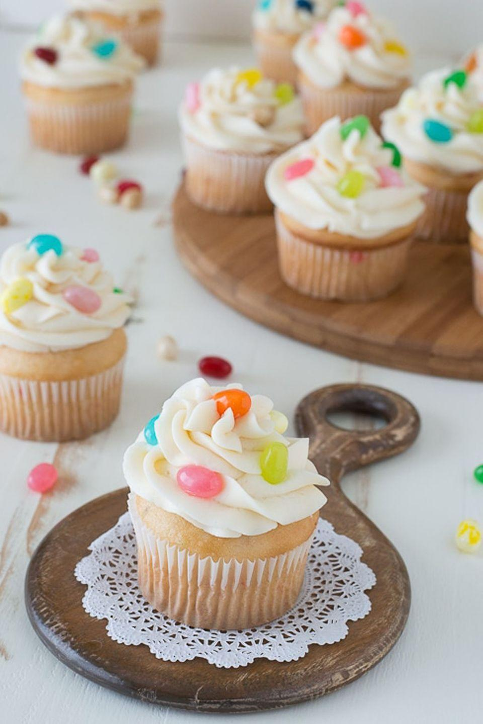 """<p>Intimidated by elaborate cupcake decorations? Just sprinkle a colorful assortment of sugary-sweet jelly beans and call it a day. </p><p>Get the full recipe from <a href=""""https://thefirstyearblog.com/jelly-belly-jelly-bean-cupcakes/"""" rel=""""nofollow noopener"""" target=""""_blank"""" data-ylk=""""slk:The First Year Blog"""" class=""""link rapid-noclick-resp"""">The First Year Blog</a>.</p>"""