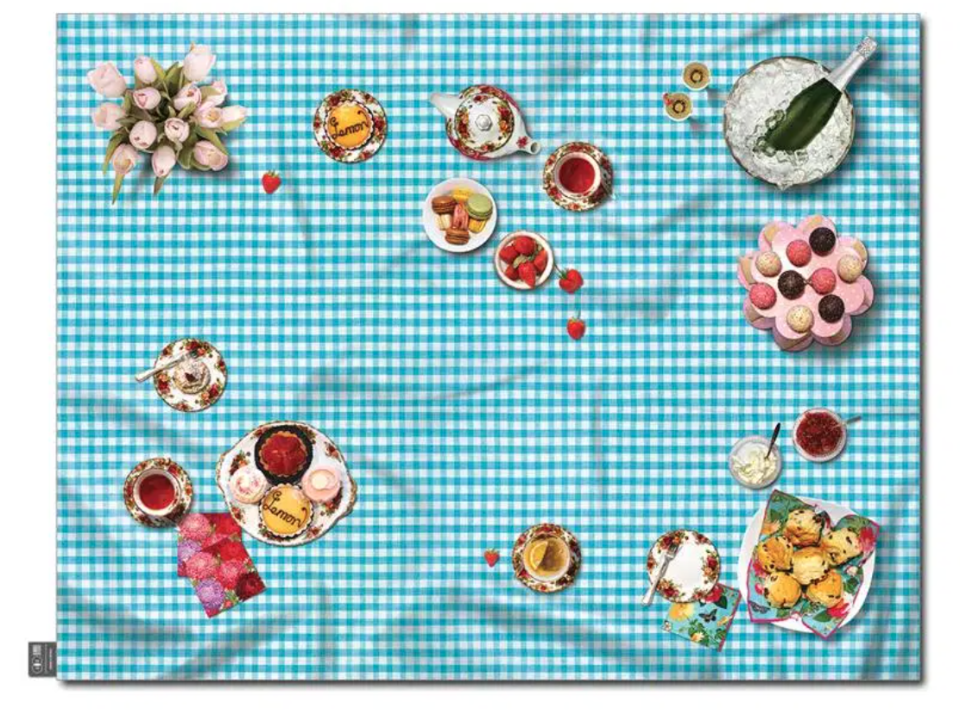 a picnic rug with a tea party set up