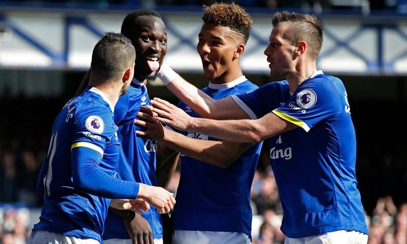 Romelu Lukaku celebrates scoring Everton's third goal against Burnley with teammates.