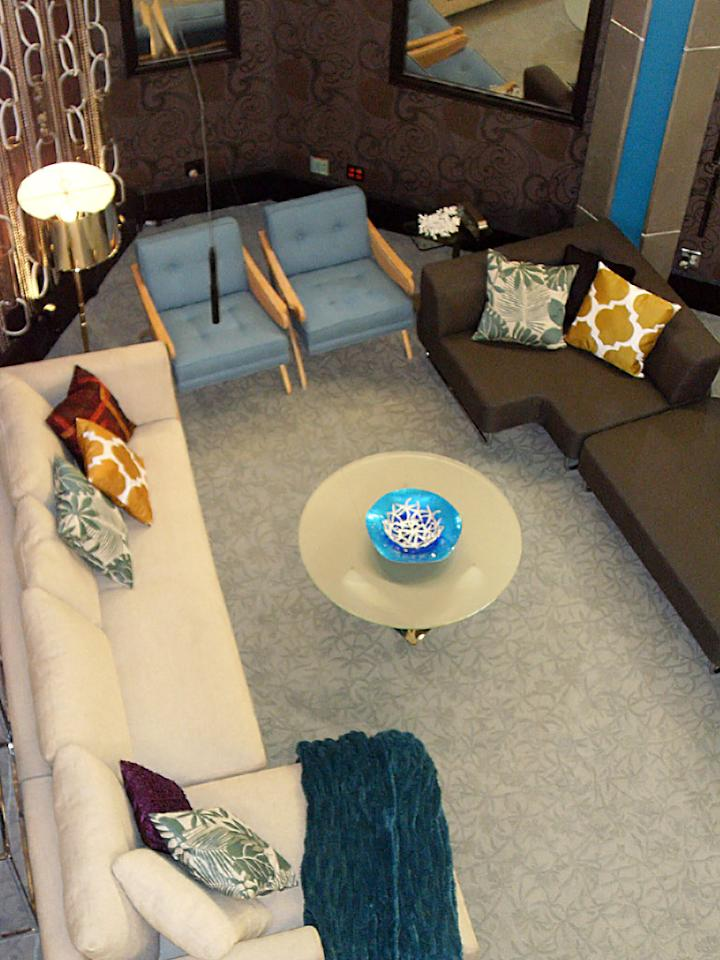 When Houseguests are up for eviction, they'll be sitting (and sweating) in the blueberry-colored chairs, which are flanked by two large sofas.