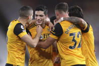 Wolverhampton Wanderers' Raul Jimenez, second left, celebrates after scoring his side's opening goal during the English Premier League soccer match between Wolves and Newcastle United at Molineux Stadium in Wolverhampton, England, Sunday, Oct. 25, 2020. (Alex Pantling/Pool Photo via AP)
